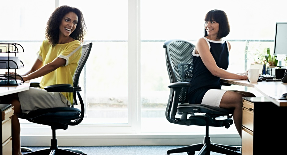 Group of young office workers seated on ergonomic chairs